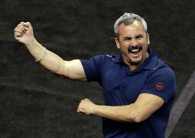 Coach Yin Alvarez reacts after a performance by his son Danell Leyva on the floor exercise during the preliminary round of the men's Olympic gymnastics trials Thursday, June 28, 2012, in San Jose, Calif.  (AP Photo/Jae C. Hong) Photo: Associated Press