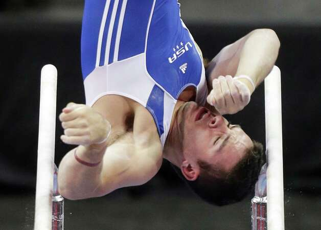 Alex Buscaglia competes on the parallel bars during the preliminary round of the men's Olympic gymnastics trials Thursday, June 28, 2012, in San Jose, Calif.  (AP Photo/Julie Jacobson) Photo: Associated Press