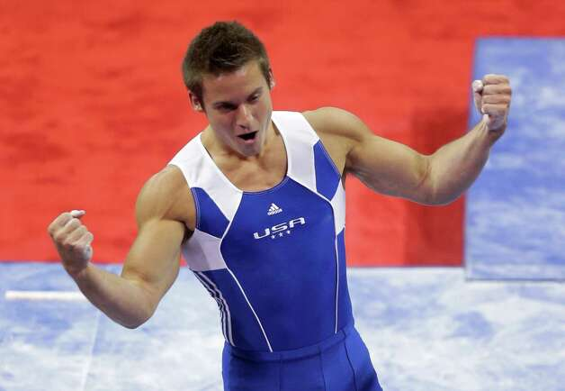Sam Mikulak reacts after competing on the parallel bars during the preliminary round of the men's Olympic gymnastics trials Thursday, June 28, 2012, in San Jose, Calif.  (AP Photo/Julie Jacobson) Photo: Associated Press