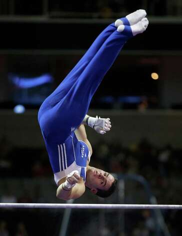 Alex Buscaglia competes on the horizontal bar during the preliminary round of the men's Olympic gymnastics trials Thursday, June 28, 2012, in San Jose, Calif.  (AP Photo/Jae C. Hong) Photo: Associated Press