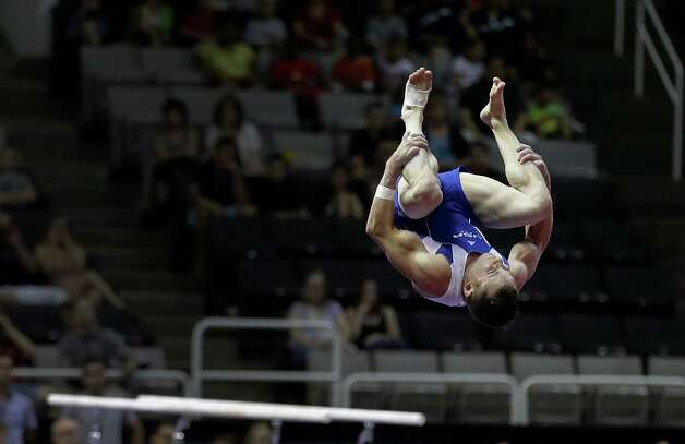 Jonathan Horton flips off the vault during the preliminary round of the men's Olympic gymnastics trials Thursday, June 28, 2012, in San Jose, Calif.  (AP Photo/Gregory Bull) Photo: Associated Press