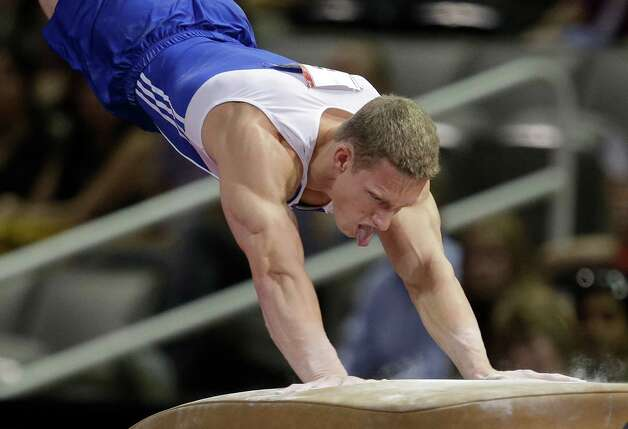 Steve Legendre rebounds off the vault during the preliminary round of the men's Olympic gymnastics trials Thursday, June 28, 2012, in San Jose, Calif.  (AP Photo/Jae C. Hong) Photo: Associated Press