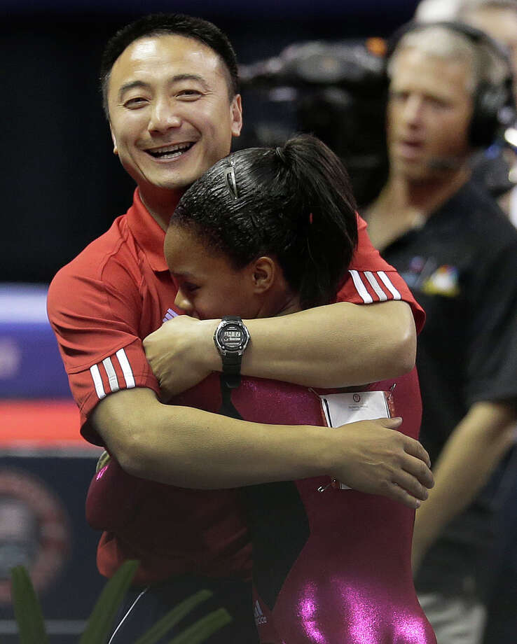 Gabby Douglas hugs her coach Liang Chow after performing her floor exercise routine during the preliminary round of the women's Olympic gymnastics trials, Friday, June 29, 2012, in San Jose, Calif. (AP Photo/Jae C. Hong) Photo: Associated Press