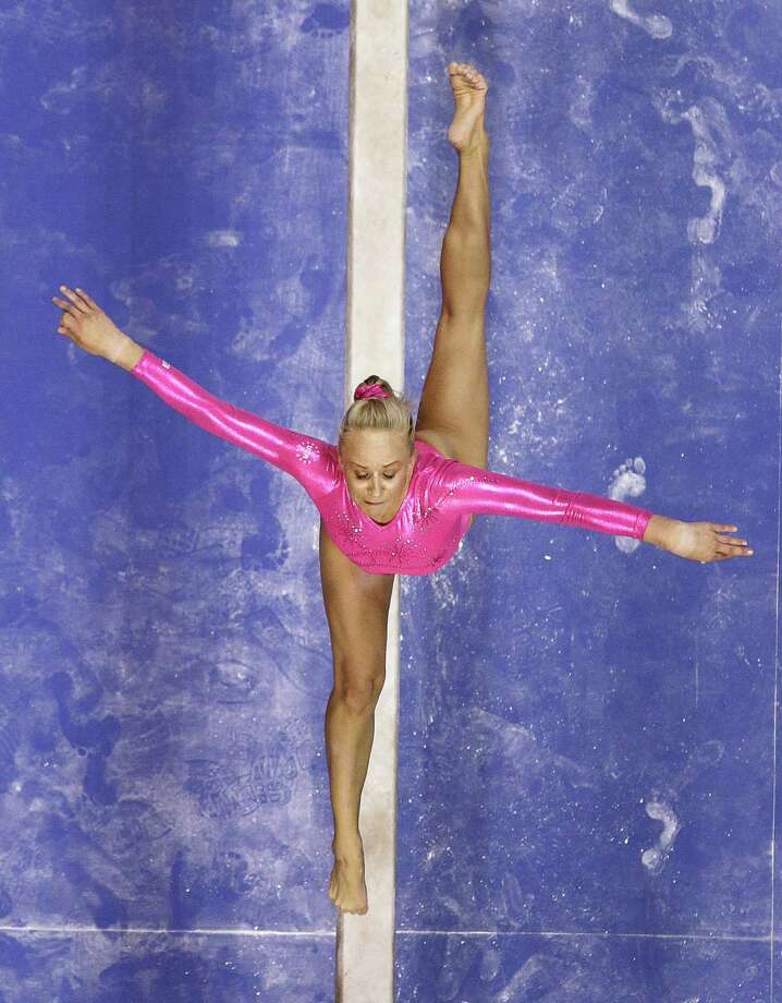 Nastia Liukin performs on the balance beam during the preliminary round of the women's Olympic gymnastics trials, Friday, June 29, 2012, in San Jose, Calif. (AP Photo/Julie Jacobson) Photo: Associated Press