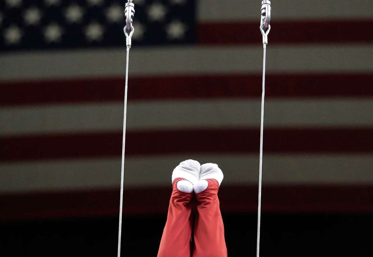 John Orozco prepares to compete on the rings during the final round of the men's Olympic gymnastics trials, Saturday, June 30, 2012, in San Jose, Calif. Orozco and Danell Leyva were named as two of five members of the U.S. Olympic team. (AP Photo/Jae C. Hong)