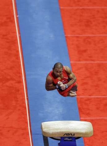 John Orozco spins off the vault during the final round of the men's Olympic gymnastics trials, Saturday, June 30, 2012, in San Jose, Calif. Orozco was named to the U.S. Olympic team. (AP Photo/Gregory Bull) Photo: Associated Press