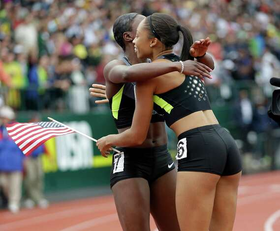 Allyson Felix, right, and Jeneba Tarmoh embrace after the finish of the women's 200 meters at the U.S. Olympic Track and Field Trials Saturday, June 30, 2012, in Eugene, Ore. Felix won the 200 but she and Tarmoh tied for third place in the 100 meters. (AP Photo/Marcio Jose Sanchez) Photo: Associated Press