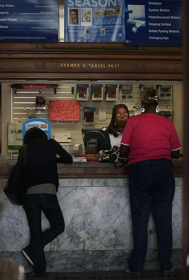 U.S. Postal Service officials are seeking a buyer for the downtown Berkeley post office to help cut a $9 billion deficit brought on largely by the digital age. Photo: Liz Hafalia, The Chronicle