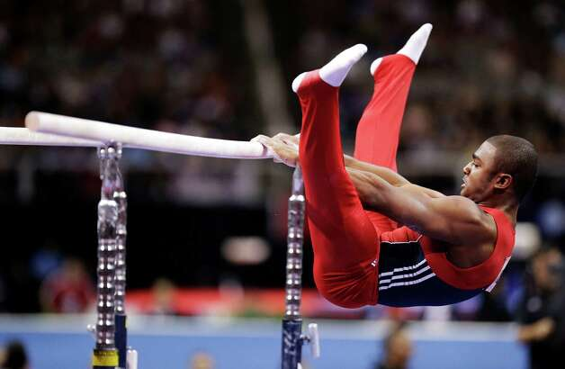 John Orozco performs on the parallel bars during the final round of the men's Olympic gymnastics trials, Saturday, June 30, 2012, in San Jose, Calif. Orozco and Danell Leyva were named to the U.S. Olympic team. (AP Photo/Jae C. Hong) Photo: Associated Press