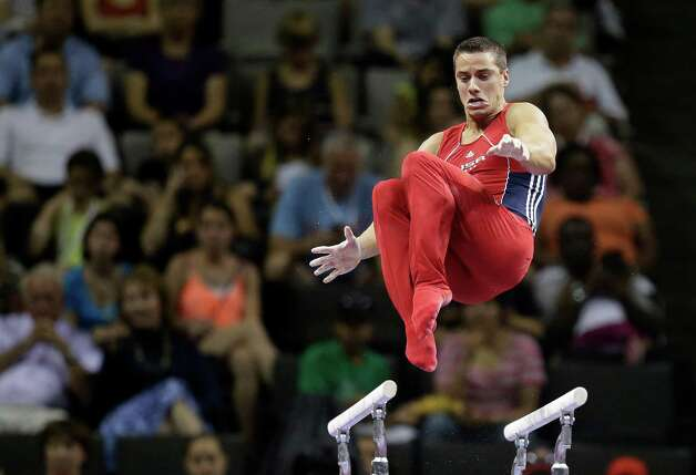 Jake Dalton performs on the parallel bars during the final round of the men's Olympic gymnastics trials, Saturday, June 30, 2012, in San Jose, Calif.(AP Photo/Jae C. Hong) Photo: Associated Press