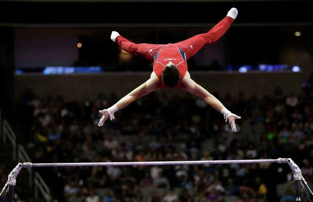 David Sender competes on the horizontal bar during the final round of the men's Olympic gymnastics trials, Saturday, June 30, 2012, in San Jose, Calif. (AP Photo/Gregory Bull) Photo: Associated Press