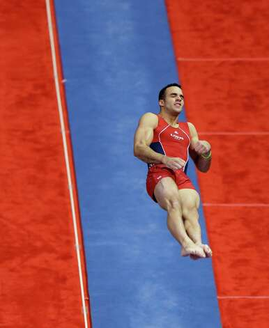 Danell Leyva flips off the vault during the final round of the men's Olympic gymnastics trials, Saturday, June 30, 2012, in San Jose, Calif. Leyva won the all-around competition and will be on the U.S. Olympic team. (AP Photo/Gregory Bull) Photo: Associated Press