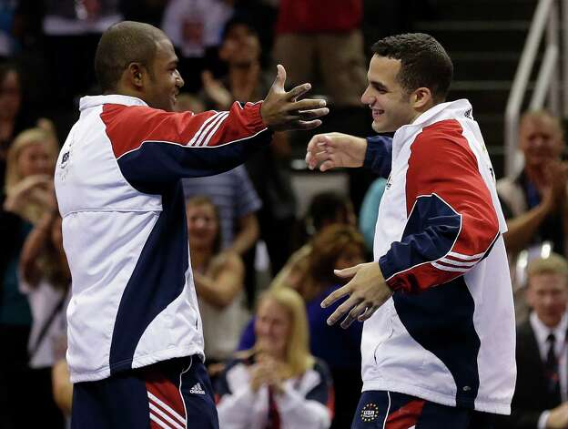 Danell Leyva, left, and John Orozco react as they are introduced as the first two members of the U.S. men's Olympic gymnastics team after the final round of the men's Olympic gymnastics trials, Saturday, June 30, 2012, in San Jose, Calif. (AP Photo/Gregory Bull) Photo: Associated Press
