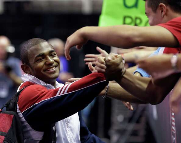 John Orozco is greeted by fans after winning a spot on the U.S. men's Olympic gymnastics team after the final round of the men's Olympic gymnastics trials, Saturday, June 30, 2012, in San Jose, Calif. (AP Photo/Gregory Bull) Photo: Associated Press