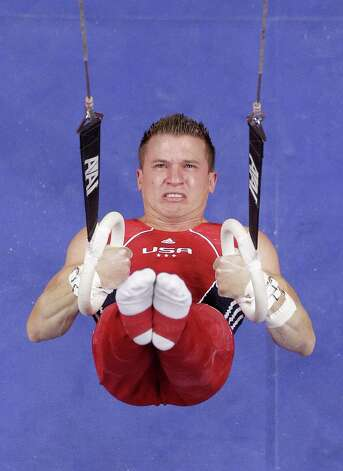 Jonathan Horton begins his routine on the rings during the final round of the men's Olympic gymnastics trials, Saturday, June 30, 2012, in San Jose, Calif. (AP Photo/Jae C. Hong) Photo: Associated Press
