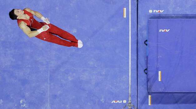 David Sender dismounts the horizontal bar during the final round of the men's Olympic gymnastics trials, Saturday, June 30, 2012, in San Jose, Calif. (AP Photo/Gregory Bull) Photo: Associated Press