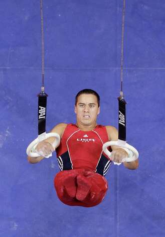 Jake Dalton competes on the rings during the final round of the men's Olympic gymnastics trials, Saturday, June 30, 2012, in San Jose, Calif. (AP Photo/Jae C. Hong) Photo: Associated Press