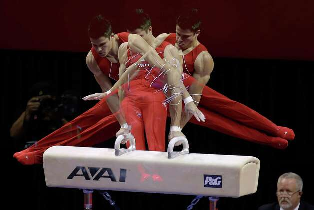 In this multiple exposure photo taken at one-quarter second intervals, Chris Brooks competes on the pommel horse during the final round of the men's Olympic gymnastics trials, Saturday, June 30, 2012, in San Jose, Calif. (AP Photo/Julie Jacobson) Photo: Associated Press