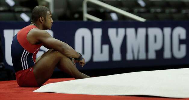 John Orozco takes a break during warm-ups for the men's final round of the  Olympic gymnastics trials, Saturday, June 30, 2012, in San Jose, Calif. (AP Photo/Jae C. Hong) Photo: Associated Press