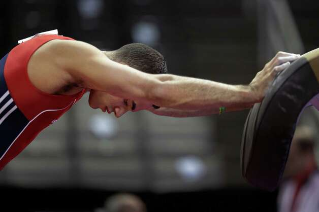 Danell Leyva stretches before competing in the final round of the men's Olympic gymnastics trials, Saturday, June 30, 2012, in San Jose, Calif. (AP Photo/Jae C. Hong) Photo: Associated Press