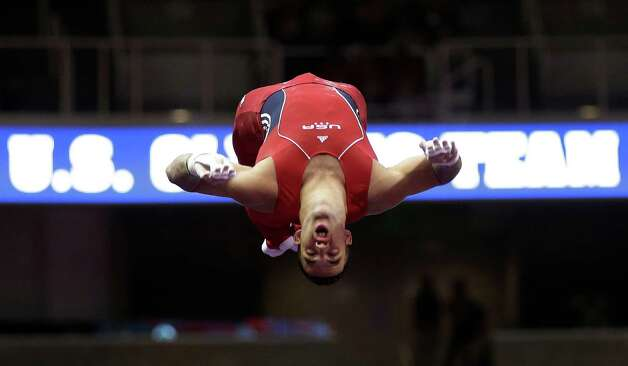 Danell Leyva competes on the horizontal bar during the final round of the men's Olympic gymnastics trials, Saturday, June 30, 2012, in San Jose, Calif. (AP Photo/Gregory Bull) Photo: Associated Press
