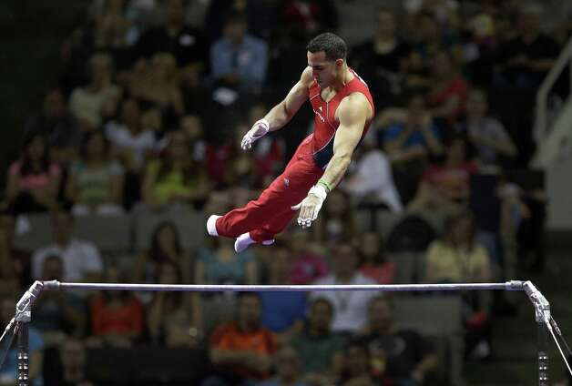 Danell Leyva competes on the horizontal bar during the final round of the men's Olympic gymnastics trials, Saturday, June 30, 2012, in San Jose, Calif. (AP Photo/Jae C. Hong) Photo: Associated Press