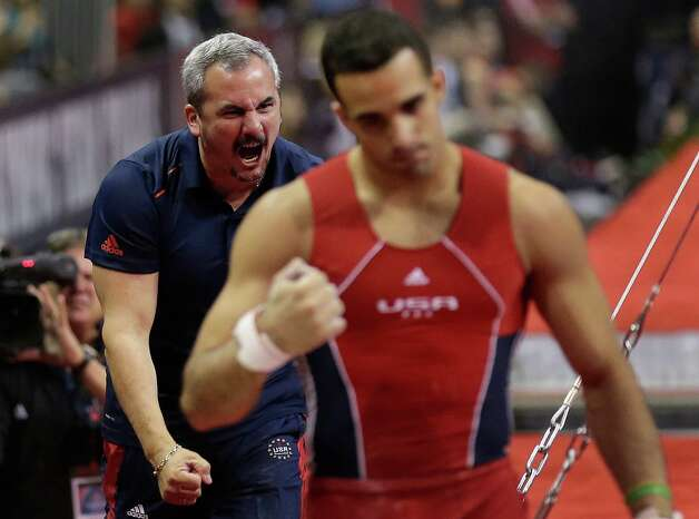 Coach Yin Alvarez, left, reacts after his step son, Danell Leyva's performance on the horizontal bar during the final round of the men's Olympic gymnastics trials, Saturday, June 30, 2012, in San Jose, Calif. (AP Photo/Gregory Bull) Photo: Associated Press