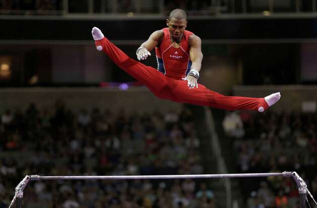 John Orozco soars above the horizontal bar during the final round of the men's Olympic gymnastics trials, Saturday, June 30, 2012, in San Jose, Calif. (AP Photo/Gregory Bull) Photo: Associated Press