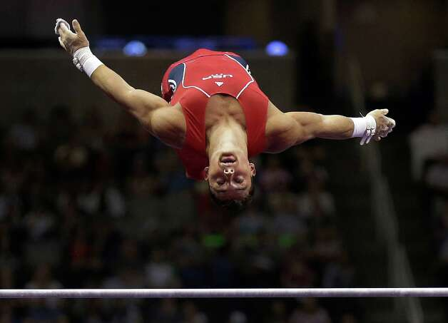 Brandon Wynn competes on the horizontal bar during the final round of the men's Olympic gymnastics trials, Saturday, June 30, 2012, in San Jose, Calif. (AP Photo/Gregory Bull) Photo: Associated Press