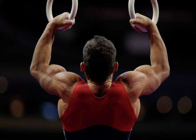 Brandon Wynn prepares to compete on the rings during the final round of the men's Olympic gymnastics trials, Saturday, June 30, 2012, in San Jose, Calif. (AP Photo/Jae C. Hong) Photo: Associated Press