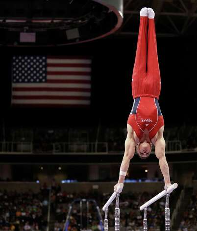 Jonathan Horton competes on the parallel bars during the final round of the men's Olympic gymnastics trials, Saturday, June 30, 2012, in San Jose, Calif. (AP Photo/Gregory Bull) Photo: Associated Press