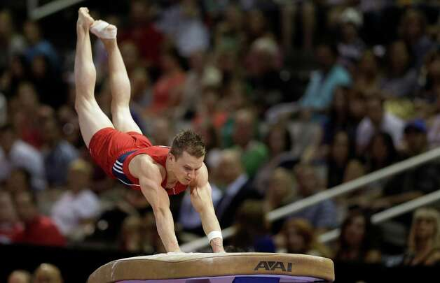 Jonathan Horton pushes off the vault during the final round of the men's Olympic gymnastics trials, Saturday, June 30, 2012, in San Jose, Calif. (AP Photo/Gregory Bull) Photo: Associated Press