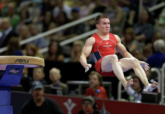 Jonathan Horton competes on the vault during the final round of the men's Olympic gymnastics trials, Saturday, June 30, 2012, in San Jose, Calif. (AP Photo/Gregory Bull) Photo: Associated Press