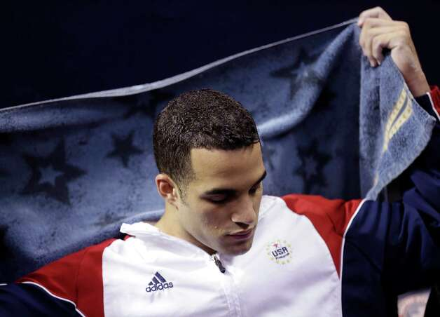 Danell Leyva rests on the bench while waiting his turn on the rings during the final round of the men's Olympic gymnastics trials, Saturday, June 30, 2012, in San Jose, Calif. (AP Photo/Gregory Bull) Photo: Associated Press