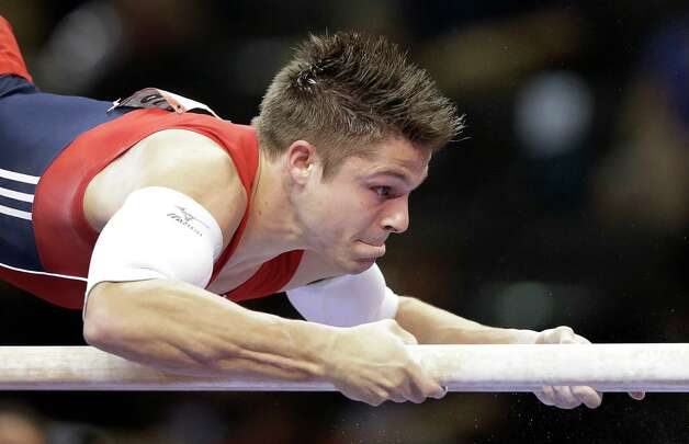Chris Brooks competes on the parallel bars during the final round of the men's Olympic gymnastics trials, Saturday, June 30, 2012, in San Jose, Calif. (AP Photo/Gregory Bull) Photo: Associated Press