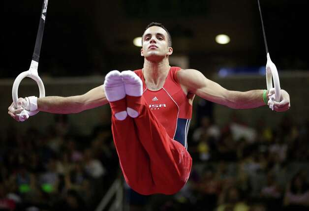 Danell Leyva competes on the rings during the final round of the men's Olympic gymnastics trials, Saturday, June 30, 2012, in San Jose, Calif. Danell won the men's all-around title and was named as one of five members of the U.S. Olympic team. (AP Photo/Jae C. Hong) Photo: Associated Press