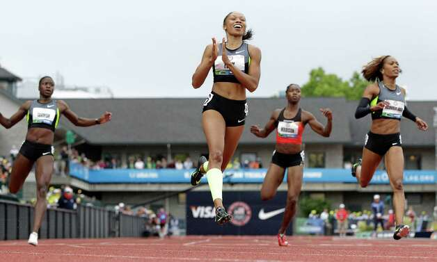 Allyson Felix, center, celebrates her first place finish in the women's 200 meters at the U.S. Olympic Track and Field Trials Saturday, June 30, 2012, in Eugene, Ore.  (AP Photo/Eric Gay) Photo: Associated Press