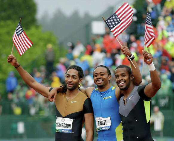 Jason Richardson, left, Aries Merritt, center, and Jeffrey Porter celebrate after in the top three in the men's 110 meter hurdles at the U.S. Olympic Track and Field Trials Saturday, June 30, 2012, in Eugene, Ore. (AP Photo/Marcio Jose Sanchez) Photo: Associated Press