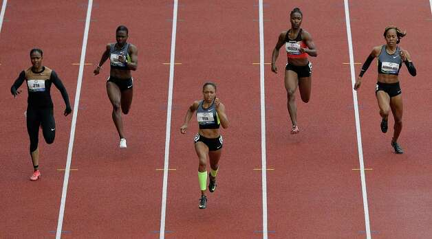 Allyson Felix, center, leads the pack in the women's 200 meter final at the U.S. Olympic Track and Field Trials Saturday, June 30, 2012, in Eugene, Ore. At rear, from left, are Carmelita Jeter, Jeneba Tarmoh, Tianna Madison and Sanya Richards-Ross. (AP Photo/Charlie Riedel) Photo: Associated Press