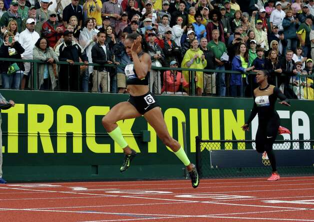 Allyson Felix and Carmelita Jeter race in the women's 200 meter final at the U.S. Olympic Track and Field Trials Saturday, June 30, 2012, in Eugene, Ore. (AP Photo/Matt Slocum) Photo: Associated Press