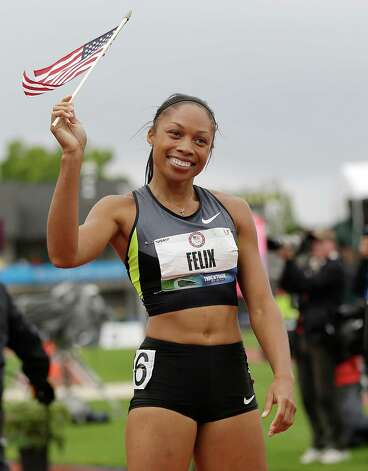 Allyson Felix celebrates her win in the women's 200 meters at the U.S. Olympic Track and Field Trials Saturday, June 30, 2012, in Eugene, Ore. (AP Photo/Marcio Jose Sanchez) Photo: Associated Press