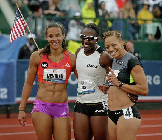 Heptathletes Chantae McMillan, left, Sharon Day, center, and Hyleas Fountain celebrate making it to the Olympics at the U.S. Olympic Track and Field Trials Saturday, June 30, 2012, in Eugene, Ore.  (AP Photo/Matt Slocum) Photo: Associated Press