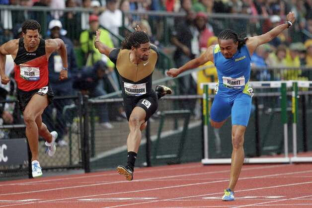 Aries Merritt, right, lunges past Jason Richardson, center, to win the men's 110 meter hurdles at the U.S. Olympic Track and Field Trials Saturday, June 30, 2012, in Eugene, Ore. Ryan Wilson is at left. (AP Photo/Marcio Jose Sanchez) Photo: Associated Press