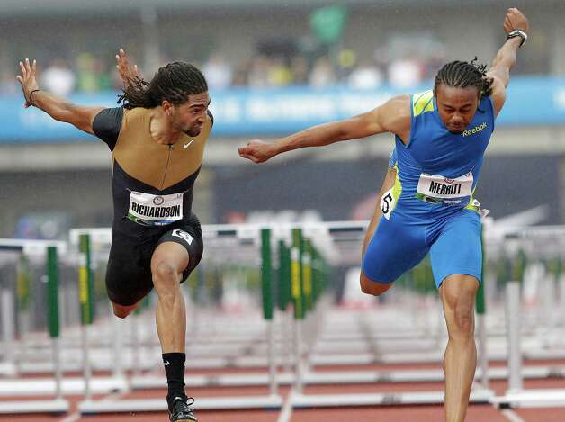 Aries Merritt, right, lunges past Jason Richardson to win the men's 110 meter hurdles at the U.S. Olympic Track and Field Trials Saturday, June 30, 2012, in Eugene, Ore. (AP Photo/Eric Gay) Photo: Associated Press