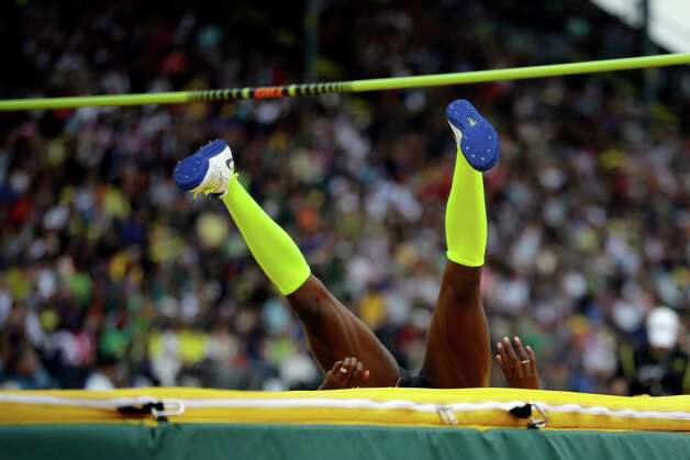 Chaunte Lowe lands after a successful jump during the women's high jump at the U.S. Olympic Track and Field Trials Saturday, June 30, 2012, in Eugene, Ore. (AP Photo/Matt Slocum) Photo: Associated Press
