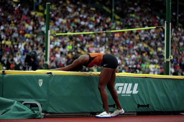 Shanay Briscoe reacts after a missed jump at the U.S. Olympic Track and Field Trials Saturday, June 30, 2012, in Eugene, Ore. (AP Photo/Matt Slocum) Photo: Associated Press