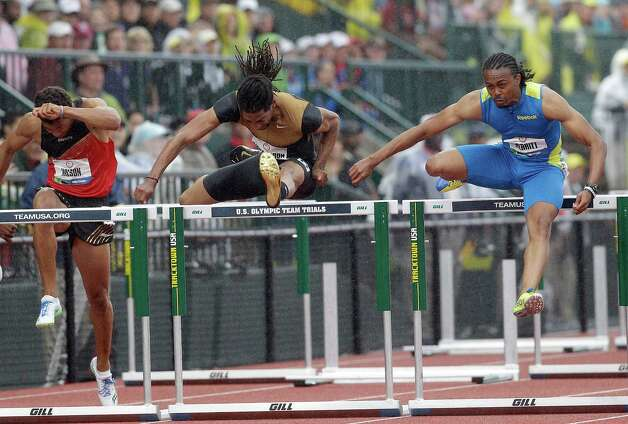 Aries Merritt, right, and Jason Richardson compete in the men's 110 meter hurdles at the U.S. Olympic Track and Field Trials Saturday, June 30, 2012, in Eugene, Ore. Ryan Wilson is at left. (AP Photo/Marcio Jose Sanchez) Photo: Associated Press