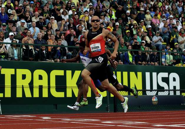 Wallace Spearmon Jr. crosses the finish line during the men's 200 meter semi-final at the U.S. Olympic Track and Field Trials Saturday, June 30, 2012, in Eugene, Ore. (AP Photo/Matt Slocum) Photo: Associated Press