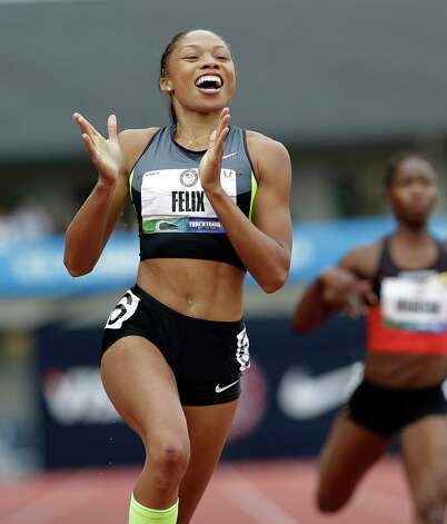Allyson Felix celebrates her first place finish in the women's 200 meters at the U.S. Olympic Track and Field Trials Saturday, June 30, 2012, in Eugene, Ore. (AP Photo/Eric Gay) Photo: Associated Press