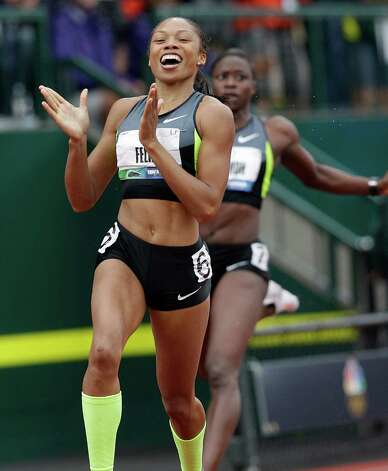 Allyson Felix celebrates her first place finish in the women's 200 meters at the U.S. Olympic Track and Field Trials Saturday, June 30, 2012, in Eugene, Ore. At right rear is Jeneba Tarmoh. (AP Photo/Marcio Jose Sanchez) Photo: Associated Press
